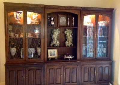 large-cabinet-with-ornaments-arranged-senior-move
