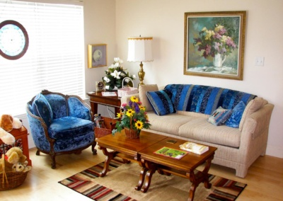 All furniture and ornaments carefully unpacked and arranged during move of elderly couple to retirement community.
