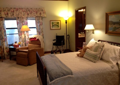 Elderly couple worked with professional organizers to create a cozy, organized master bedroom.