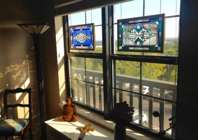 Stained glass art carefully hung in seniors independent living apartment.