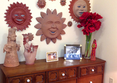 A wall of sun ornaments arranged by senior move managers in Austin