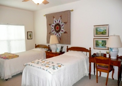 Senior move managers unpacked and set up bedroom for seniors who downsized their home.
